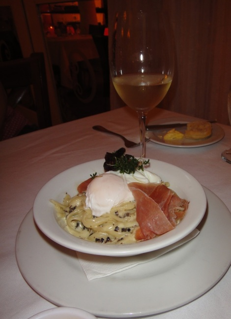 Truffle spaghetti with serano ham and a poached egg.