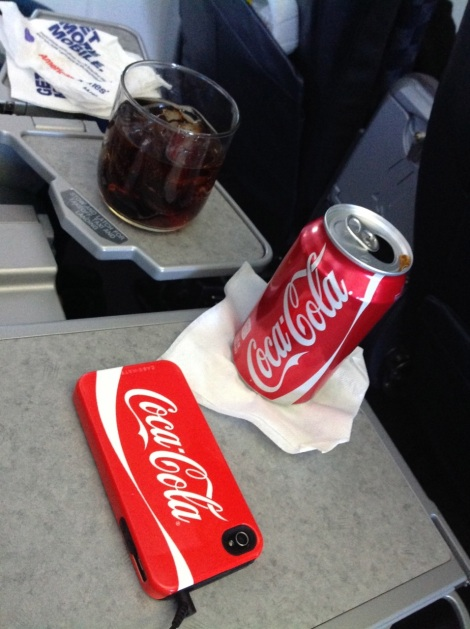 Enjoying Coca-Cola at 36,000 feet.