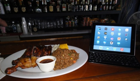 Chicken, ribs, rice, and iPad at lunch in Aruba.