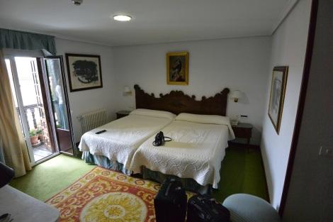 Bedroom in junior suite at Hotel Museo Los Infantes, Santillana del Mar, Spain.
