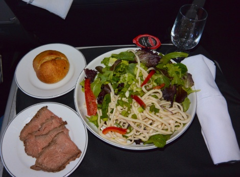 Chilled beef with udon noodle salad aboard American Airlines.