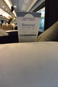 Card marking reserved seat on East Coast Line train to Edinburgh, Scotland.