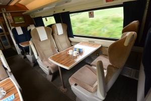 First Class seating aboard East Coast Line train to Edinburgh, Scotland.