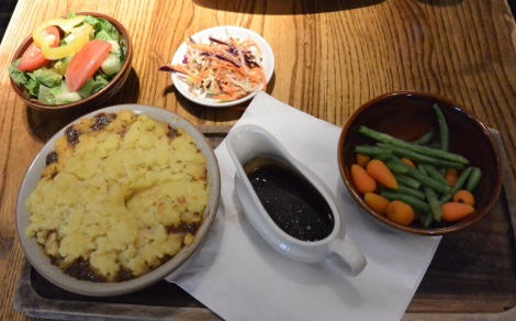 Cottage pie with veggies, crunch slaw, and salad at Deacon Brodie's Tavern, Edinburgh, Scotland.