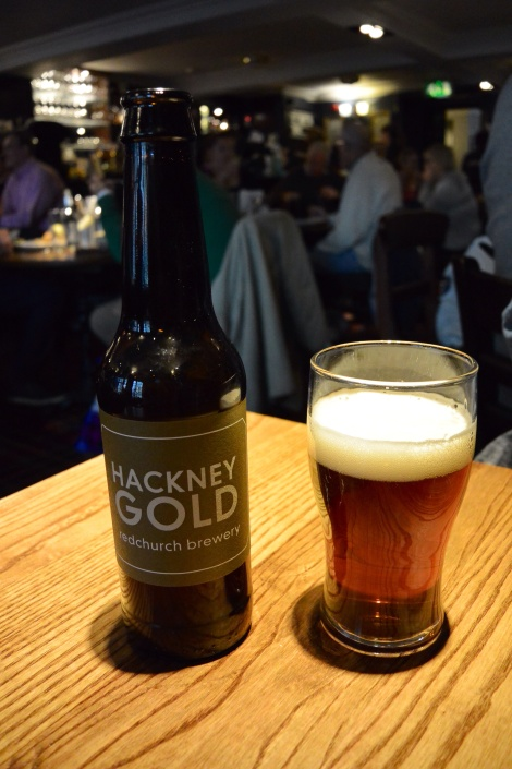 Hackney Gold, one of the many beers on tap and in the bottle at Deacon Brodie's Tavern, Edinburgh, Scotland.