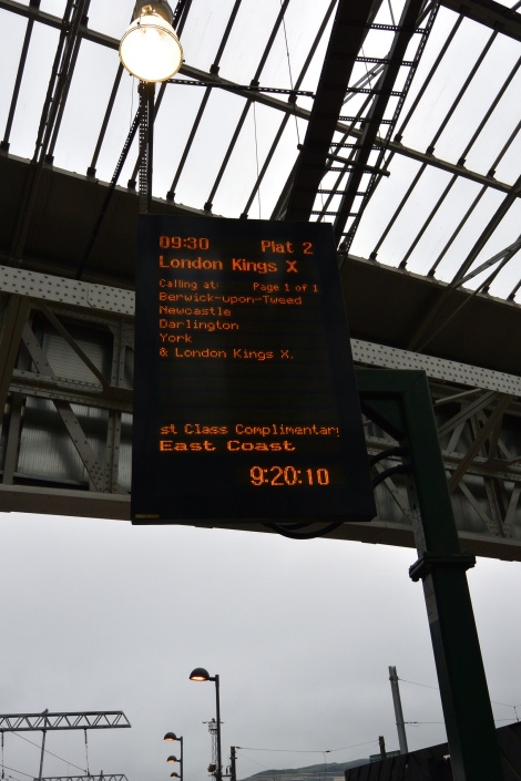 Digital screen displaying train info at Waverly Station, Edinburgh, Scotland.