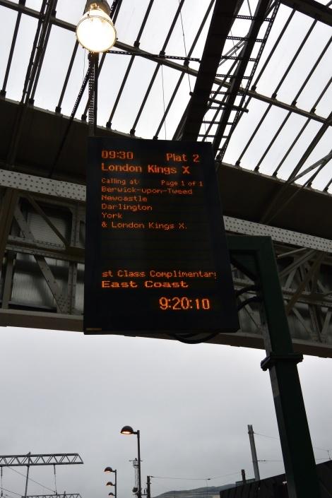 Digital screen displaying train info at Waverly Station, Edinburgh, Scotland.