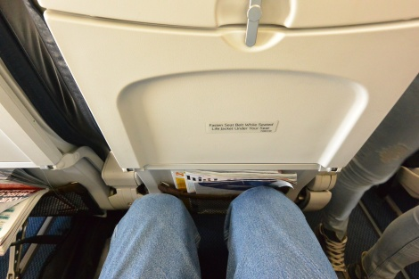 "Cramped seating in ""business class"" aboard British Airways 2708, Airbus 319."