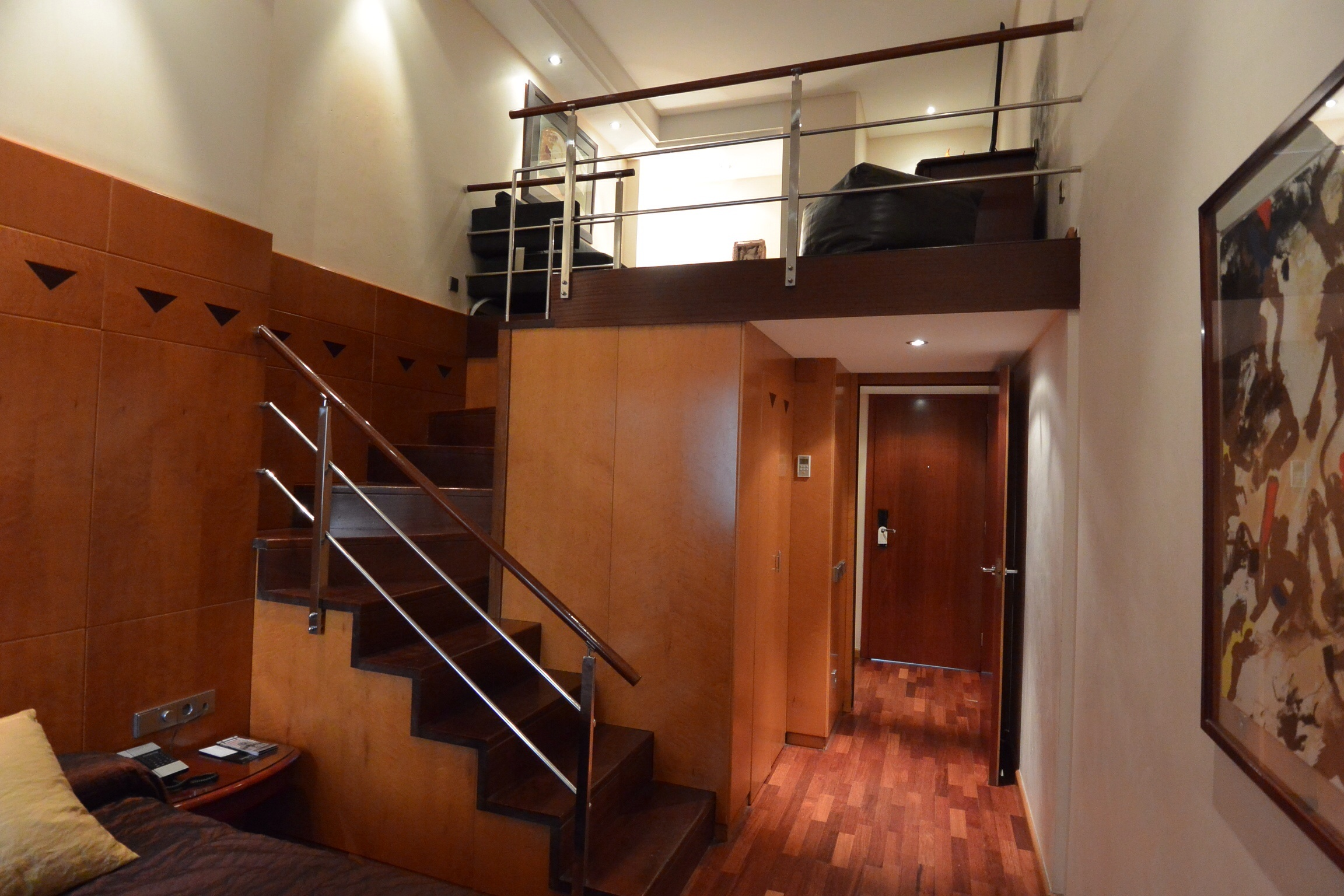 entrance to and staircase inside duplex room at hotel pau claris barcelona spain