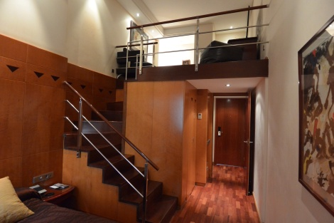Entrance to and staircase inside duplex room at Hotel Pau Claris, Barcelona, Spain.
