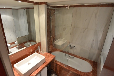 Sink and shower in duplex room at Hotel Pau Claris, Barcelona, Spain.