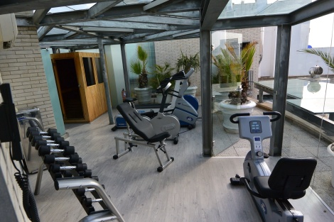 Gym and sauna on the rooftop at Hotel Pau Claris, Barcelona, Spain.