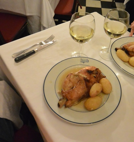 Roast chicken with potatoes at Restaurante Botín, Madrid, Spain.