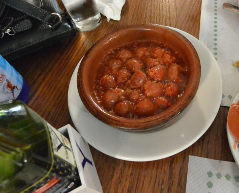Sausages cooked in wine at Cerveceria Rua Bella, Santiago de Compostela, Spain.