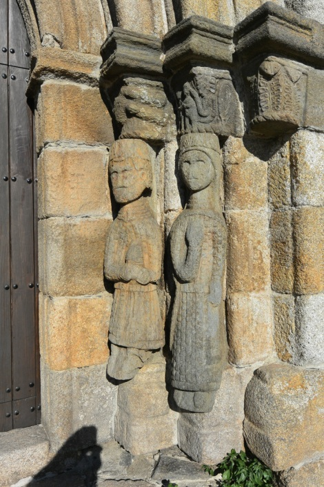 Carved statues at church entrance, Puebla de Sanabria, Spain.