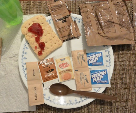 The wheat bread snack with strawberry jam and contents of the utensil/flavor pack of XMRE, Menu 3.