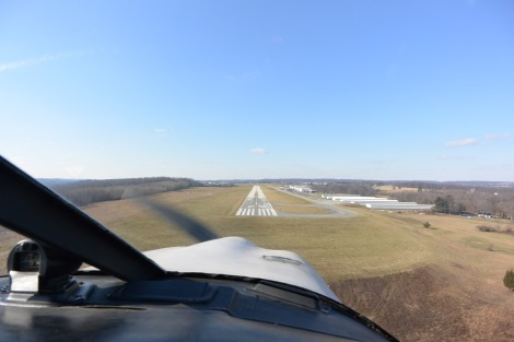 Final approach to Runway 29 at Chester County Airport, KMQS.